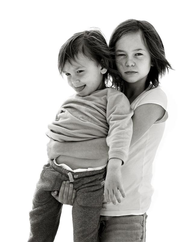 Girl holding boy
